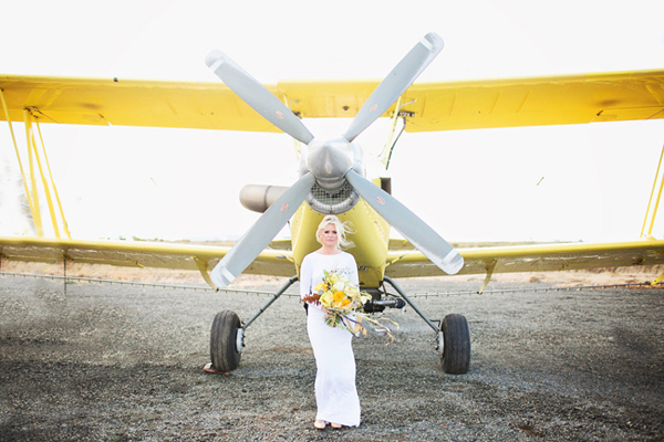 Ruffled - photo by http://www.sarahtamagniphoto.com/ - http://ruffledblog.com/stormy-day-plane-hangar-wedding